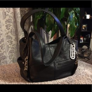 Genuine black leather, leopard interior B Makowsky